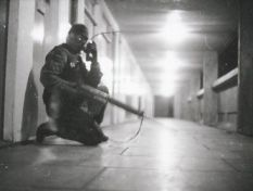 A soldier from the First Gloucesters uses a Stornophone type radio while on patrol in Divis Flats in April 1972 (Copyright: The Soldiers of Gloucestershire)